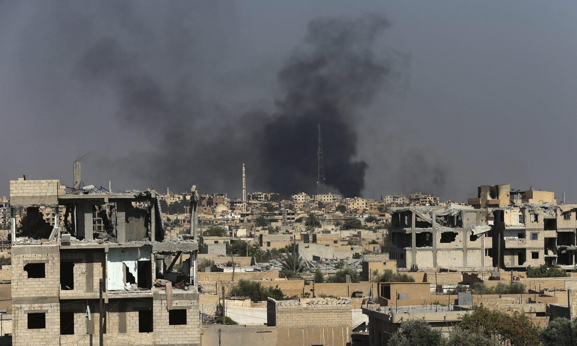 Smoke rises in Raqqa, Syria.