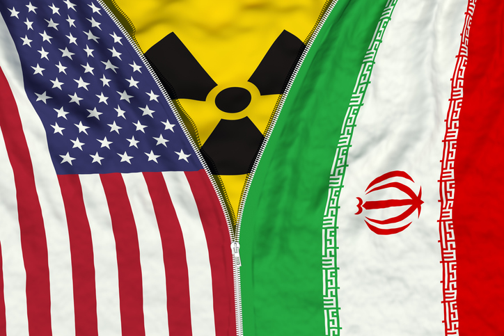 Zipper separates or connects US and Iranian flags with radiation symbol